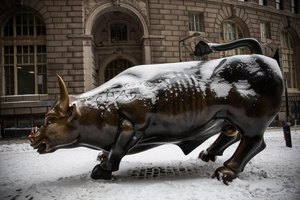 The Wall Street Bull covered in a light layer of snow.