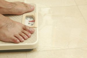 Man's feet on a bathroom scale.