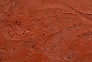 Terra-cotta refers to fired clay items, but it is also a brown-orange color.