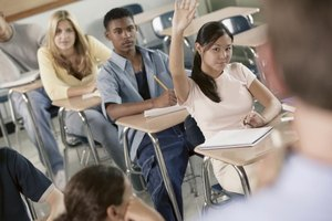 Student raising her hand in classroom