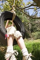 A tire swing is one option for a recycled playground.