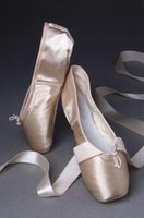 Pink satin pointe shoes.
