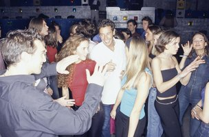 Group of adults dancing at a nightclub.