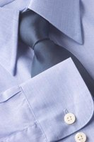Leave the stays in your shirt but remove any pins before wearing it.