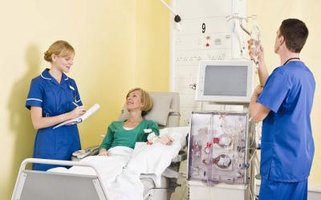 Hemodialysis technicians monitor their patients' vital signs during dialysis treatment.