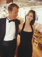 A tuxedo and floor-length gown are appropriate for black tie affairs.
