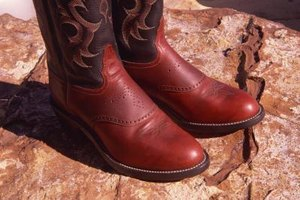 You can shrink stretched out boots by using a little vinegar.