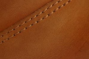 Use a soft touch when cleaning designer leather.