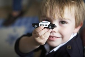 Children can make a police car out of craft materials.
