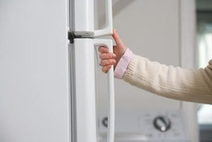 You may need to detach your refrigerator's door handles to remove fingerprints.