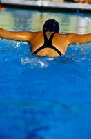 The butterfly stroke gives you the best upper-body workout, developing your biceps, triceps, deltoids and neck muscles.