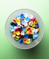 Recycle water bottle caps into items for your home and garden decor.
