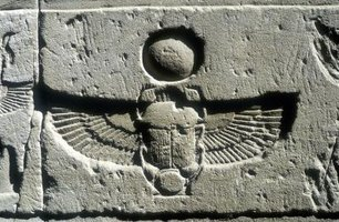 Ancient Egyptian scarab beetle and vulture wings
