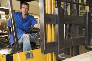 A warehouse worker operates a forklift