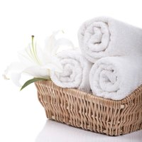Rolled bright-white towels add a spa feel to a room.