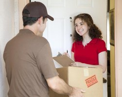 Man delivering a box to a smiling woman.