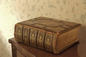 Spine of antiqued Bible sitting on table