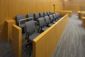 Seats for the jury in a court room.
