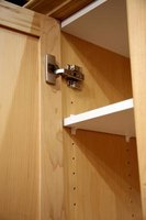 Shelf peg cabinets have adjustable shelves.