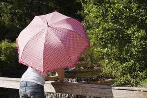 Umbrellas provide shade as well as protection from the rain.