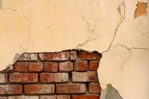 Old brick walls can lose their mortar and crumble when wet.