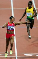 Carmelita Jeter crosses the line with a world record in the 2012 Olympic 4 x 100-meter relay.
