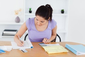 Young adult woman looking over tax documents