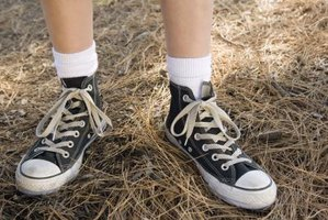 There are an example of Chuck Taylors tied in a traditional manner.
