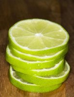 Sliced limes lining a glass vase create an interesting centerpiece.
