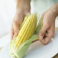 Peel back the husk to make certain that the corn is healthy before roasting.