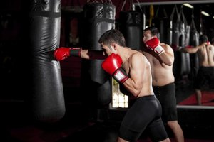 Punching the bag as hard as possible builds upper-body power.