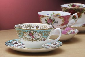 Look on the bottom of saucers, dishes and cups for hallmarks or monograms.