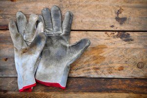 Gardening gloves on a wood deck