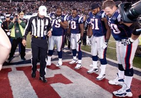 Referee flips coin at NFL football game