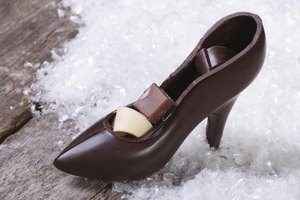 A chocolate shoe filled with chocolates.