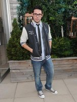 "Designer Christopher Straub Wears a varsity jacket to a season premiere of ""Project Runway"" at the Empire Hotel in New York."