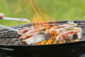 Close-up of fish being grilled on barbecue.