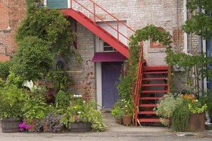 Old exterior red brick benefits from pops of color and seasonal greenery.