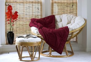 Papasan chair and throw with matching ottoman.