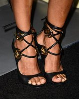 Halle Berry wears a sexy pair of lace-up sandals from Giuseppe Zanotti.
