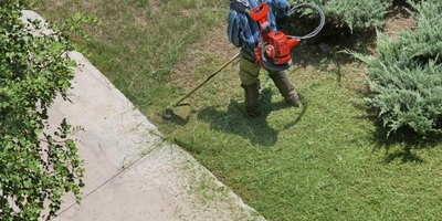 City dwellers with limited yard space often cut their grass with a string trimmer.