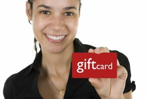 Woman holding a gift card.