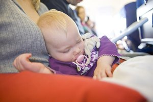 Book flights that coincide with her nap time.