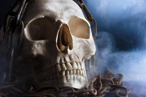 A human skull with smoke and chains.