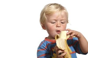 A banana is an easy-to-chew food that adds nutrition to your toddler's lunch.