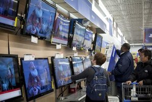 Customers shopping for electronics in a superstore.