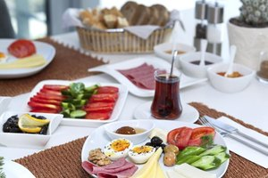 An array of Mediterranean style breakfast foods on a table.