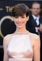 Anne Hathaway wears a pale pink dress at the Oscars in Hollywood, California in 2013.