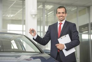 A car rental agent holds a car key and clipboard.