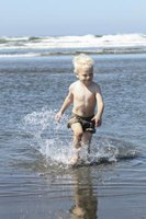 A young visitor makes a splash on the beach at Ocean Shores.